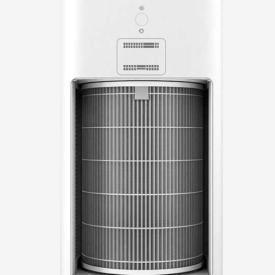 Oczyszczacz powietrza Xiaomi Air Purifier 2H na szarym tle z widocznym filtrem cylindrycznym.